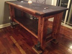"""3 x 7 and 42"""" high Pub Table with big casters.  Legs are 6x6 posts from 1905 barn. Super cool!"""