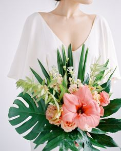 Some of the most beautiful and exotic plants originate in tropical locations. These lush greens aren't only for destination events. #Wedding #Flowers #Tropical #Summer #Green #WeddingFlowers #WeddingIdeas #WeddingBouquets | Martha Stewart Weddings - 20 Tropical Leaf Wedding Bouquets
