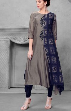 Silk grey and blue print kurti with superb embroidery detailing.