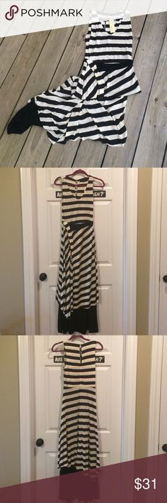 NWT Double Layered Striped Maxi Dress This dress has a gorgeous drape to it!  Black and cream stripes over a solid black jersey knit. There is a twisted detail at the waist with a solid black band--almost simulating a belt. Very flattering!  Throw on a denim jacket and it's great for fall! Sugar Lips Dresses Maxi