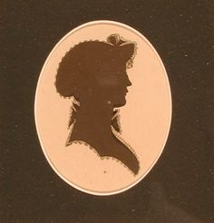 antique hollow-cut silhouette of Hartford's Morgan Family with interesting painted embellishments