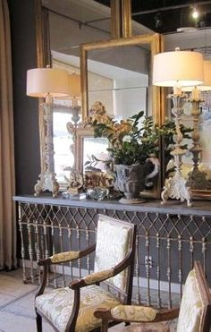 Lisa Luby Ryan. Yes! Framed mirrors on a mirror wall. Love the lamps, the furniture, the old chairs . . . .   KathrynHaydenKimmons   Syle