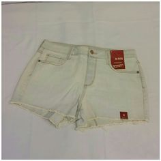 """40% BUNDLE DISCOUNT! FREE SHIPPING ON BUNDLES! Total Distressed Washedout, Frayed Hem Shorts,size 11, New With Tag, tan threads create a dirty rusty illusion, V'd yoke center back below waistband, slight white whiskering below front pockets, machine washable, 15"""" waist laying flat, 11 1/2"""" front length waist to hem, 13"""" back length waist to hem, 2"""" inseam, 11"""" rise. ADD TO A BUNDLE! 40% BUNDLE DISCOUNT! FREE SHIPPING ON BUNDLES!! """"OFFER"""" 40% less Plus $6 LESS ON BUNDLES for shipping…"""