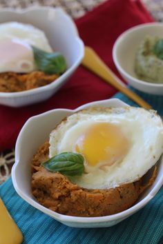 """Easy spin on breakfast or """"Crockpot baked sweet potatoes mixed with Dairy free pesto topped with fried eggs""""- paleo"""