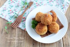 Potato, onion and canned tuna balls mixed with salt, pepper, curry powder and mayo covered in flour, beaten egg and panko then fried.