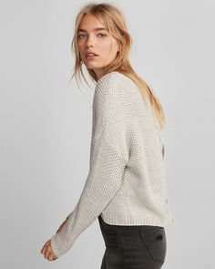 A chic sweater that keeps your look in the now with a lace-up split 72d69db64
