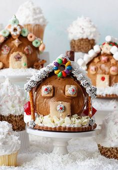 Chocolate candy house with frosting. Group together cakes, pretzels and chocolate candies to make this wonderful and delicious candy house ensemble with a Christmas theme.