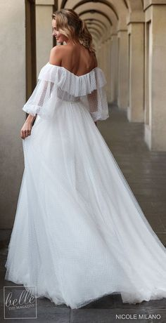 Unique bohemian ball gown wedding dress with long balloon sleeves and off the shoulder ruffle neckline | Nicole Milano Wedding Dresses 2021 Collection- Belle The Magazine #weddingdress #weddingdresses #bridalgown #bridal #bridalgowns #weddinggown #bridetobe #weddings #bride #dreamdress #bridalcollection #bridaldress #dress See more gorgeous bridal gowns by clicking on the photo