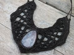 This Spider web collar was handmade Crochet by me with tourmalinated quartz & dark brown threads.