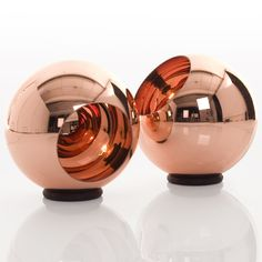 Copper floor lamp. A polycarbonate globe with an internal coating of metal that gives the characteristic mirror finish. Designed by Tom Dixon.