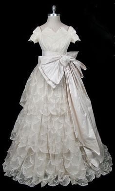 Wedding gown, French, 1955. Made of lace, silk, and taffeta.
