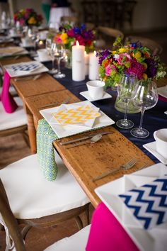 Wooden farm tables bring a touch of rustic to this #whimsical and #bright table design #berkshirewed #taraconsolatievents #tabledesign