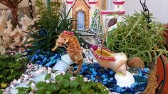 DIY Fairy Garden Seahorse Chariot/Carriage.  This was made with some sea shells, beads and jewelry wire. #fairygarden #diyfairygarden #chariot #carriage