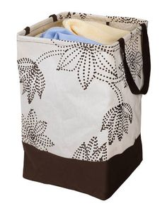 """At just 12"""" x 12"""", this compact hamper from Umbra is the perfect space-saver for cozy rooms."""