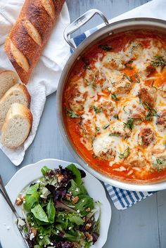Baked chicken parmesan meatballs in tomato cream sauce.