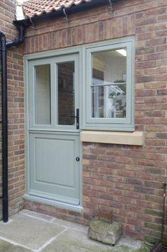 Timber stable door with neighbouring flush casement window