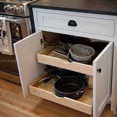 new pot and pans storage in new kitchen remodel Best Kitchen Cabinets, New Kitchen, Kitchen Appliances, Whitewash Cabinets, Pan Storage, Cabinet Companies, Custom Cabinetry, Cool Kitchens, Countertops