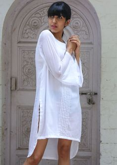 White mulmul shirt dress dresses and tunics This Handcrafted White Mulmul Shirt Dress is an elegant top in pure white which is evergreen and can never go out of vogue pair up with your denim is apt for any day and anytime. The style which you can pull it off almost with everything yet you look stylish. * White plain mulmul * Knife pleated at center front * Bell Sleeves * Cotton Mulmul