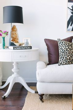 """Sneak Peek: A Chicago Apartment with a Sartorial Approach. """"When I found this table at a resale shop it was a dingy yellow color with a cracked leather top. I think most people would have passed it up but I knew it had potential! The lamp is a custom piece I had made out of a citrine geode. I'm in the process of having more made to sell on my website so stay tuned!"""" #sneakpeek"""