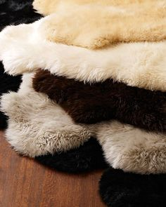 Sheepskin+Rug+at+Horchow. 8 colors, all on sale, various sizes
