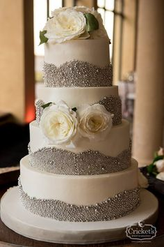 White and silver buttercream wedding cake by Party Flavors Custom Cakes with fresh flowers | Cricket's Photography