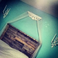 So proud of my bed I thought I'd pin it :) pallet wood headborad, old shelf and candle holders from yard sales. Add some tulle and BAM Its a fairytale
