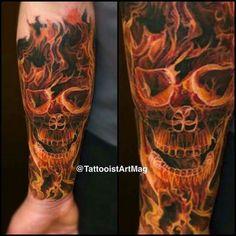 Flaming skull half-sleeve