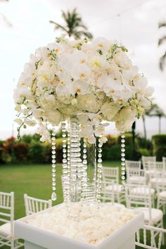 Luxurious wedding ceremony flower decor with hanging crystals and white orchids - Four Seasons Maui - Country Bouquets Maui - Anna Kim Photography