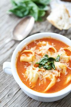 Creamy Tomato Tortellini Soup Recipe on twopeasandtheirpod.com Simple to make and SO good!