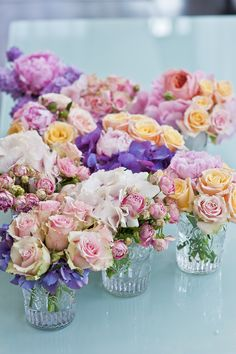 Brides Handfastings Tablescapes Weddings:  Simple flower arrangements in clear glasses.