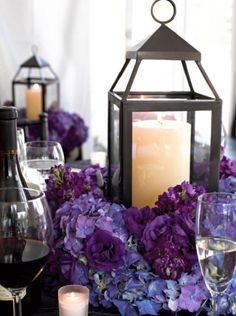 wedding candle centerpieces with purple flowers
