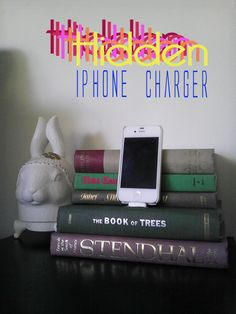 DIY hidden iphone charger bookstand - very cute, as long as you have a suitable book to sacrifice!