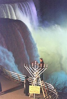 With the roar of Niagara Falls as a backdrop, members of the Western New York Jewish Community light the fifth candle of Chanukah celebration..