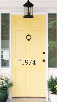 house numbers, love the yellow door and light fixture too!