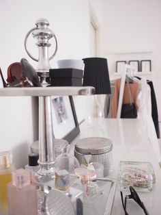 Going up with your dresser accessories keeps the rest of the top clear. Using transparent, translucent or reflective surfaces helps to keep a room light and bright. #stylecure