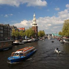 Enchanting Amsterdam: Explore scenic canals, visit world-class museums, or enjoy glorious gardens on shore in Amsterdam