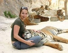 At Wat Pha Luang Ta Bua, aka the Tiger Temple in Thailand, you can snuggle a full-grown tiger. Add this to my bucket list.