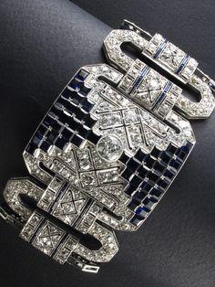 A magnificent Art Deco platinum, diamond and sapphire bracelet, circa 1930.