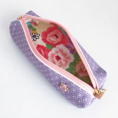 Pen case made from kimono with Japanese patterns of diamond-shaped flowers. This skinny case is easy to carry and yet holds sufficient number of pens....
