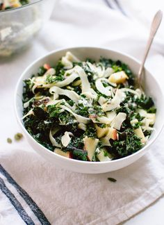Healthy kale salad featuring shaved fennel, chopped honeycrisp apple, toasted pepitas, dried cranberries and goat cheese, tossed in a lemony dressing.