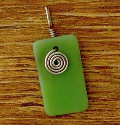 A piece of tumbled recycle glass turns magically into this Lime Green Glass Pendant above. It's one of the artist favorite colors among her piece of recycle glass. This pendant goes with nearly everything in your wardrobe.