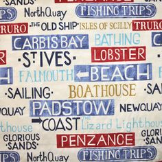 Padstow design features cornish place names [St Ives, Penzance, Truro, Newquay, Padstow] as beach signs in blues and red on an ivory material.