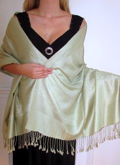 Light Green Pashmina Silk Shawl Bliss -     Click to enlarge     This Light Green Pashmina Silk Shawl Bliss with inlaid classy paisley designing is a blend of premium fine pashmina wool and high-quality silk. Raving reviews on this one! It is the perfect complement to any outfit and great for a casual or dressy look. $24.99