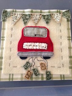 """My version, I used material left over from my sons nursery and made this for a family member...I also stitched their last name on the banner, their first initials and wedding date on the """"cans""""! I then used chalkboard paint on a small canvas and mounted it on top. I stapled a piece of ribbon for hanging as well."""
