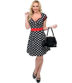 A spotted spectacle? Yes please! Presenting a bubbly fit and flare frock in overlarge black and white dots contrasted with red throughout. Crafted in a classic vintage silhouette, The Dollface dress boasts a sultry sweetheart neckline with center gathers, cuffed cap sleeves with faux button detail and flattering banded cinch at the natural waist. Made from supple stretch cotton, the pleated fit and flare skirt blooms out just above the knees for a charming effect.  <BR> Available in sizes…
