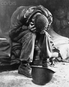 """American Soldier Weeping After Battle""  An American soldier collapses in his hands from the strain of fighting along the Taegu front, South Korea. c.1950"
