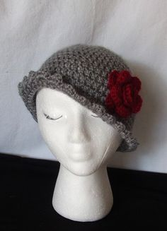 Feminine women's gray ruffle cloche with deep red rose.