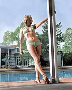 Cultural icon Marilyn Monroe, black & white photo colorized. http://www.buzzfeed.com/nicholaswray/historic-photos