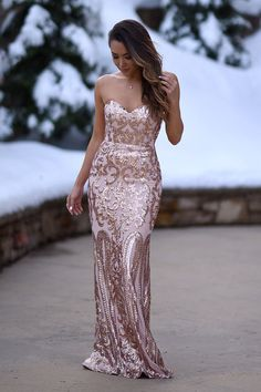 The Bariano Rebecca Rose Gold Strapless Sequin Maxi Dress is sure to make you the belle of the ball! A breathtaking rose gold sequin pattern covers a strapless, sweetheart neckline with princess seams, lightly padded cups, hidden boning and no-slip strips. Fitted bodice gives way to a flaring mermaid maxi skirt. Hidden back zipper and clasp. As Seen On Jessica of Hapa Time blog and Kemper of @joandkemp!