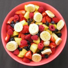 Delicious fruit salad- bananas, raspberries, blueberries,strawberries, and pineapple.